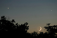 MIDDLETOWN, N.Y. - A setting crescent moon shares the western twilight sky with the planets Venus, left, and Jupiter. Sept. 6, 2005.