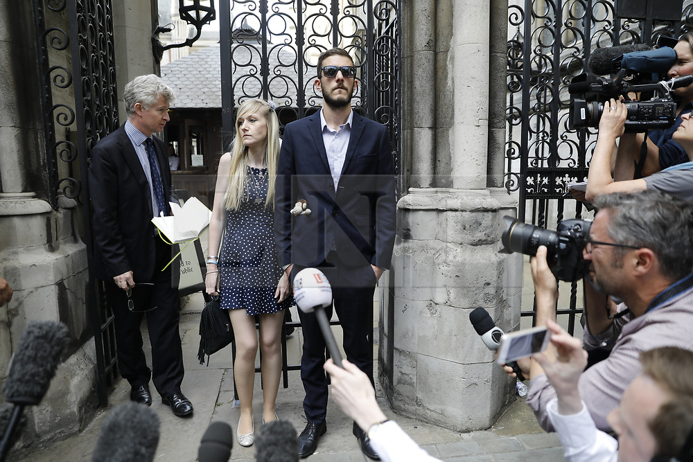 © Licensed to London News Pictures. 10/07/2017. London, UK. Connie Yates and <br /> Chris Gard give a statement at The High Court in London on 10 July 2017. The parents of terminally ill Charlie Gard have returned to the High Court in light of new evidence relating to potential treatment for their son's condition. An earlier lengthy legal battle ruled that Charlie could not be taken to the US for experimental treatment. London, UK. Photo credit: Tolga Akmen/LNP