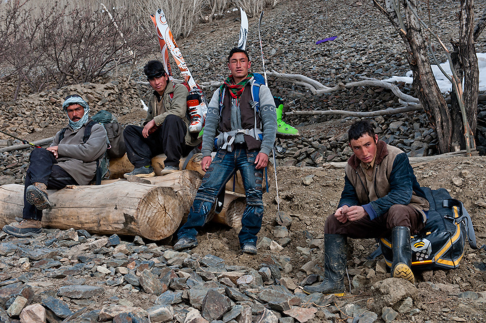 Porters carry ski equipment for foreign tourists on a backcountry skiing expedition in Bamiyan Province, Afghanistan.