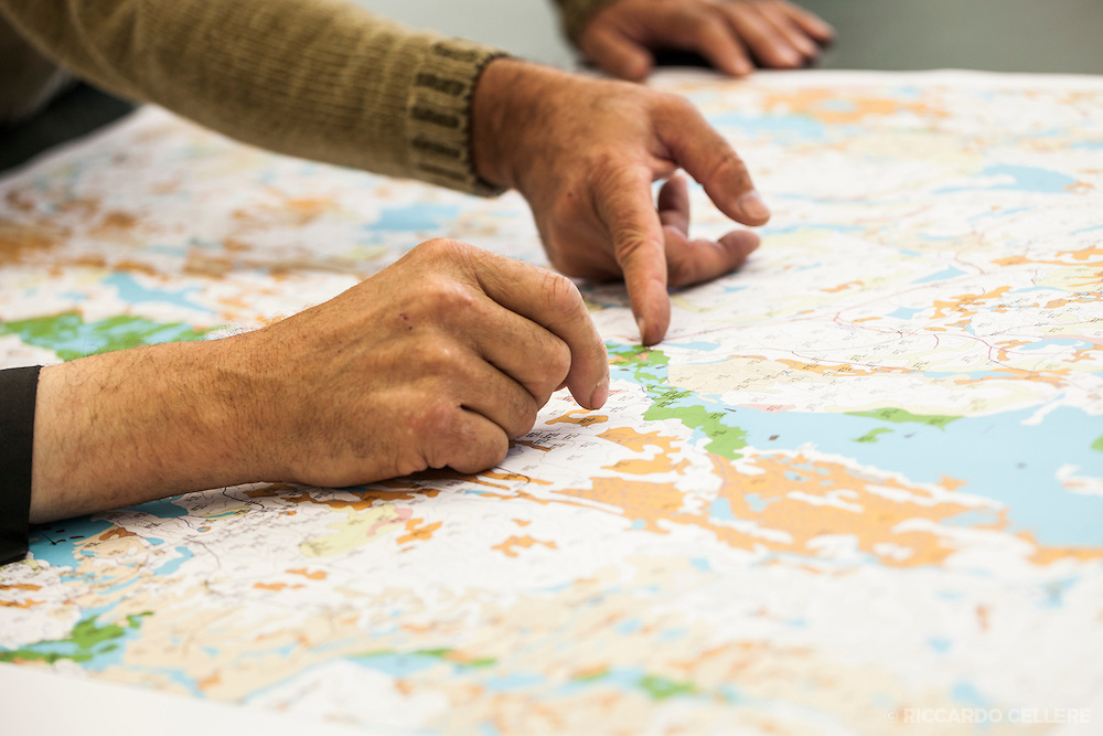Corporate photography. Pointing at a map. 2013.