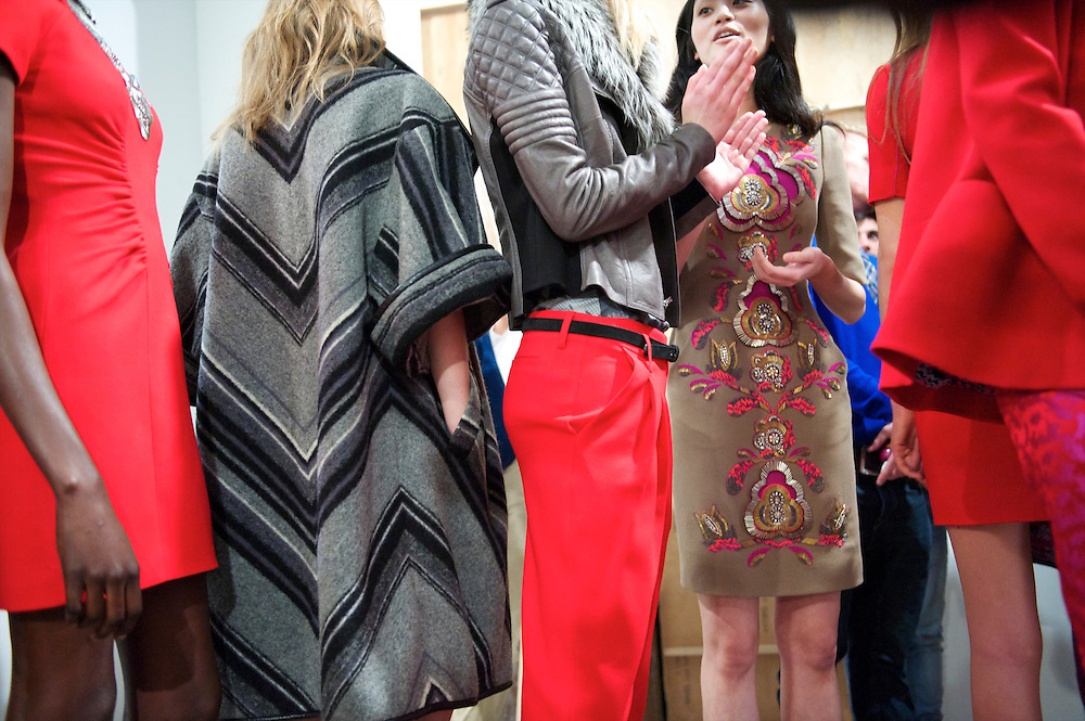 Models line up backstage before the Matthew Williamson autumn 2011 collection at Phillips de Pury Gallery in London on 20 February 2011.