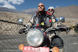 Dave Nolan with a trekker on back after riding across a narrow suspension bridge over the Kali Gandaki River on day-6 of our Himalayan Heroes adventure riding from Muktinath to Tatopani, Nepal. Sunday, November 11, 2018. Photography ©2018 Michael Lichter.