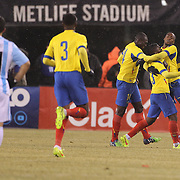 Miller Bolanos, (right), Ecuador, is congratulated by team mates after scoring a goal during the Argentina Vs Ecuador International friendly football match at MetLife Stadium, New Jersey. USA. 31st march 2015. Photo Tim Clayton