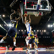 Anadolu Efes's Dogus Balbay (C) during their Turkish BEKO Basketball League derby match Anadolu Efes between Fenerbahce at Abdi ipekci Arena in Istanbul, Turkey, Monday, February 03, 2014. Photo by Aykut AKICI/TURKPIX