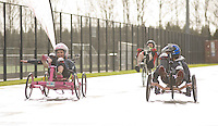 Blue Peter presenters have gone head-to-head on their personally modified bikes in a cycle race for Sport Relief 2014.  From left, Lindsey Russell, Barney Harwood and Radzi Chinyanganya during the race<br /> <br /> Photo by Chris Vaughan/CameraSport<br /> <br /> Commercial - Sport Relief -  publicity shoot - Tuesday 4th March 2014 - University of Central Lancashire Sports Arena - Preston<br /> <br /> © CameraSport - 43 Linden Ave. Countesthorpe. Leicester. England. LE8 5PG - Tel: +44 (0) 116 277 4147 - admin@camerasport.com - www.camerasport.com