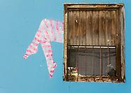 PANAMA, PANAMA - SEPTEMBER 21: Colorful graffiti by a contrasting old window. September 21, 2011.  Panama, Panamá. (Photo: Rubén Alfú / Istmophoto)