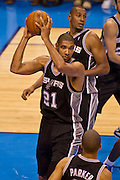 June 2, 2012; Oklahoma City, OK, USA; San Antonio Spurs forward Tim Duncan (21) pulls down a rebound during a playoff game against the Oklahoma City Thunder at Chesapeake Energy Arena.  Thunder defeated the Spurs 109-103 Mandatory Credit: Beth Hall-US PRESSWIRE