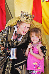 The Third Annual Santa Fe Renaissance Fair was held at Rancho de Las Golondrinas near Santa Fe in September 2010 and was a colorful and well attended event. Kimberley Stockton portrayed Queen Isabella and entertained kids like Brooke Stokes-Gialouris.