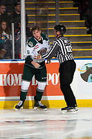 KELOWNA, BC - SEPTEMBER 28:  Linesman Dustin Minty escorts Dawson Butt #9 of the Everett Silvertips to the penaty box after instigating a third period fight against the Kelowna Rockets  at Prospera Place on September 28, 2019 in Kelowna, Canada. (Photo by Marissa Baecker/Shoot the Breeze)