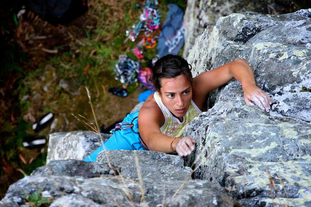 Sofia Dias leading a trad climbing route in Penacova, Portugal.