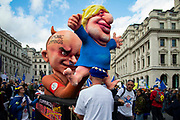 A giant caricature of Dominic Cummings and Boris Johnson seen on Piccadilly as over one million protesters take part in a march by the People's Vote Campaign in central London on 19th October 2019, calling for a final say in a second referendum on Brexit. MPs hold a rare Saturday sitting to debate Prime Minister Boris Johnson's new Brexit deal.