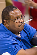 A patient has his temperature checked during a free medical mission held by the SC Hospital Association on August 23, 2013 in North Charleston, South Carolina. More than 1,000 people showed up to receive free dental and medical care.