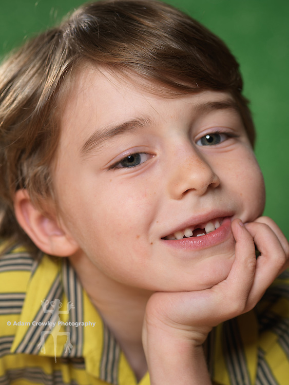 Portrait of boy (7 years old) smiling with missing front tooth.