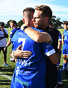 Kale Herbert hugs Mark Jones at the end of the match. ISPS Handa Men's Premiership football match between Eastern Suburbs AFC and Hamilton Wanderers at Madills Farm in Auckland. Sunday 21 February 2021. © Coyright image by Andrew Cornaga / www.photosport.nz