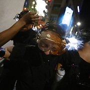 CHARLOTTE, NC - August 24:  A group of protestors, organized by Charlotte Uprising, try to leave a scrum after being sprayed with pepper spray after ongoing clashes with Charlotte-Mecklenburg police for a third night in a row as they march through uptown Charlotte near the site of the 2020 Republican National Convention in uptown Charlotte on August 24, 2020. The group, organized by Charlotte Uprising is protesting the existence of the convention in Charlotte, the policies of the Trump administration and the the abolishment of police and prisons. Delegates are holding private meetings inside the convention center ahead of the official start of the paired down convention on August 24th. (Photo by Logan Cyrus for AFP)