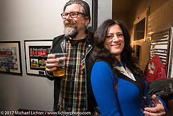 Giuseppe Roncen and Ela Dutch at Mr Martini's party at his downtown shop - restaurant after the first day of Motor Bike Expo. Verona, Italy. Friday January 20, 2017. Photography ©2017 Michael Lichter.