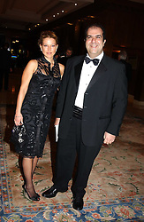 MISS DANA MALMSTROM and STELIOS HAJI-LOANNOU founder of the Easy group of companies at the Conde Nast Traveller magazine Tsunami Appeal Dinner at the Four Seasons Hotel, Hamilton Place, London W1 on 2nd March 2005.<br /><br />NON EXCLUSIVE - WORLD RIGHTS