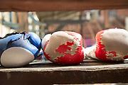Close up of boxing gloves in Gimnasio Rafael Trejo, Havana, Cuba