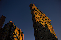 Flatiron Building in Madison Square Park in New York City. Manhattan. <br /> <br /> Photo by Robert Caplin