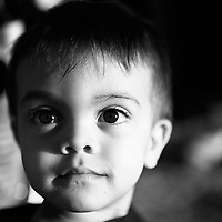 Black and white portrait of a 2 year old boy .