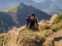 Woman enjoying hiking at top of Txindoki