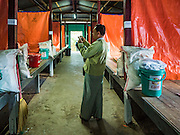 26 OCTOBER 2016 - MYAWADDY, KAYIN STATE, MYANMAR: A Burmese government officials inspects housing in a displaced persons facility for returning refugees in Myawaddy, Myanmar. Sixtyfive Burmese refugees living in the Nupo Temporary Shelter refugee camp in Tak Province of Thailand were voluntarily repatriated to Myanmar. About 11,000 people live in the camp. The repatriation was the first large scale repatriation of Myanmar refugees living in Thailand. Government officials on both sides of the Thai / Myanmar border said the repatriation was made possible by recent democratic reforms in Myanmar. There are approximately 150,000 Burmese refugees living in camps along the Thai / Myanmar border. The Thai government has expressed interest several times in the last two years in starting the process of repatriating the refugees.     PHOTO BY JACK KURTZ