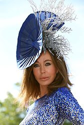 Melanie Mar poses for photographs on day three of Royal Ascot at Ascot Racecourse.
