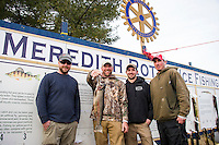 "Fishing buddies Travis Ouellette, Josh Philbrick the $15,000 winner, Ryan Clauson and Tim Ester celebrate in front of the ""wall"" Sunday afternoon after Philbrick wins the 2016 Great Meredith Rotary Ice Fishing Derby with a 4.26 lb Rainbow Trout that he caught in Alton Bay at about 630am Saturday morning.  (Karen Bobotas/for the Laconia Daily Sun)"