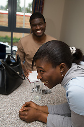 University students in discussion in student accommodation,