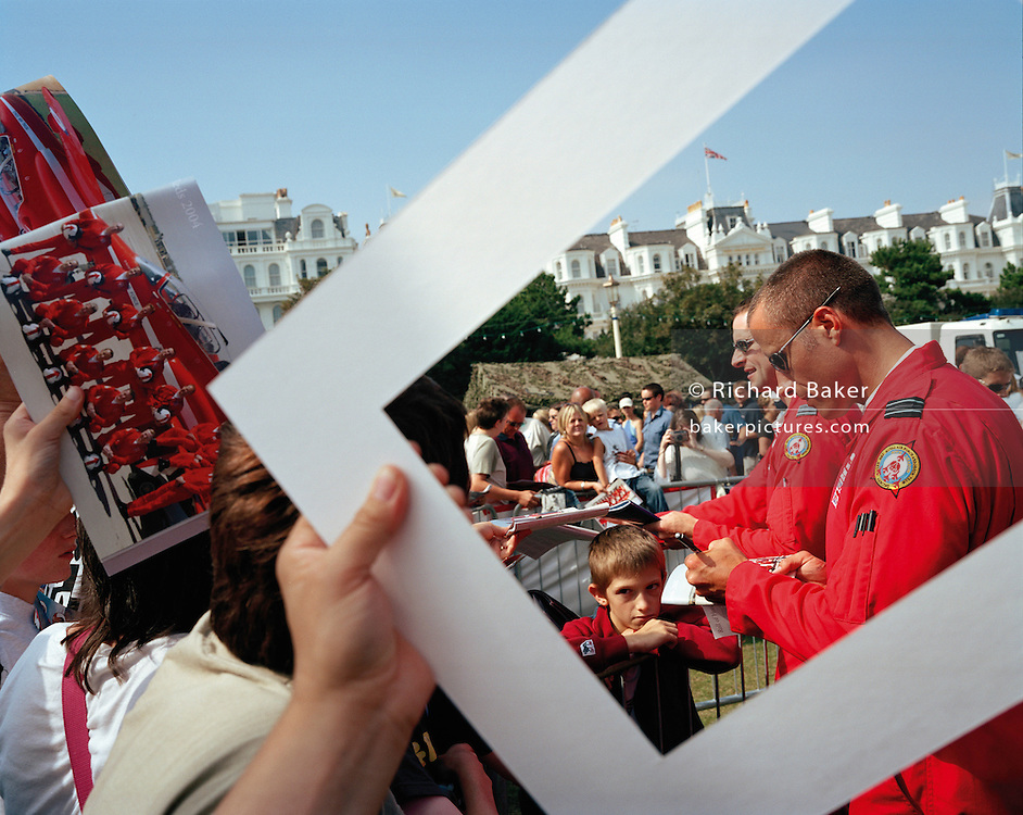 Pilots of the 'Red Arrows', Britain's Royal Air Force aerobatic team sign autograpohs before their display at Eastborne.