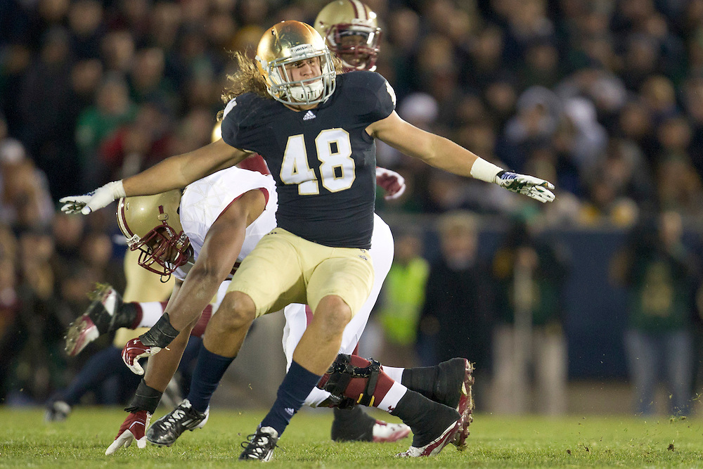 Notre Dame outside linebacker Dan Fox (#48) in pursuit of ball carrier during second quarter of NCAA football game between Notre Dame and Boston College.  The Notre Dame Fighting Irish defeated the Boston College Eagles 16-14 in game at Notre Dame Stadium in South Bend, Indiana.