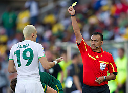 Algeria's Hassan Yebda and referee Carlos Batres (GUA) with yellow card during the Group C first round 2010 FIFA World Cup South Africa match between Algeria and Slovenia at Peter Mokaba Stadium on June 13, 2010 in Polokwane, South Africa.  Slovenia defeated Aleria 1-0. (Photo by Vid Ponikvar / Sportida)