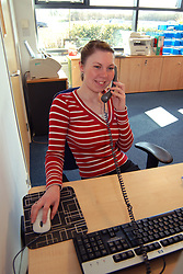 Office receptionist at her desk