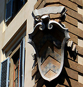Architectural street detail from Florence, Italy. Shield stonework.