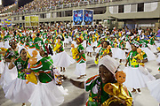 Women dressed in white, Grande Rio Samba School from the Special Group, practices their Carnival procession in the Sambadrome, Rio de Janeiro, Brazil