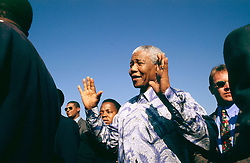 NELSON ROLIHLAHLA MANDELA (July 18, 1918 - December 5, 2013), 95, world renown civil rights activist and world leader. Mandela emerged from prison to become the first black President of South Africa in 1994. As a symbol of peacemaking, he won the 1993 Nobel Peace Prize. Joined his countries anti-apartheid movement in his 20s and then the ANC (African National Congress) in 1942. For next 20 years, he directed a campaign of peaceful, non-violent defiance against the South African government and its racist policies and for his efforts was incarcerated for 27 years. Remained strong and faithful to his cause, thru out his life, of a world of peace. Transforming the world, to make it a better place. PICTURED: 1994, South Africa - NELSON MANDELA at a rally.  (Credit Image: © Greg Marinovich/ZUMA Wire/ZUMAPRESS.com)