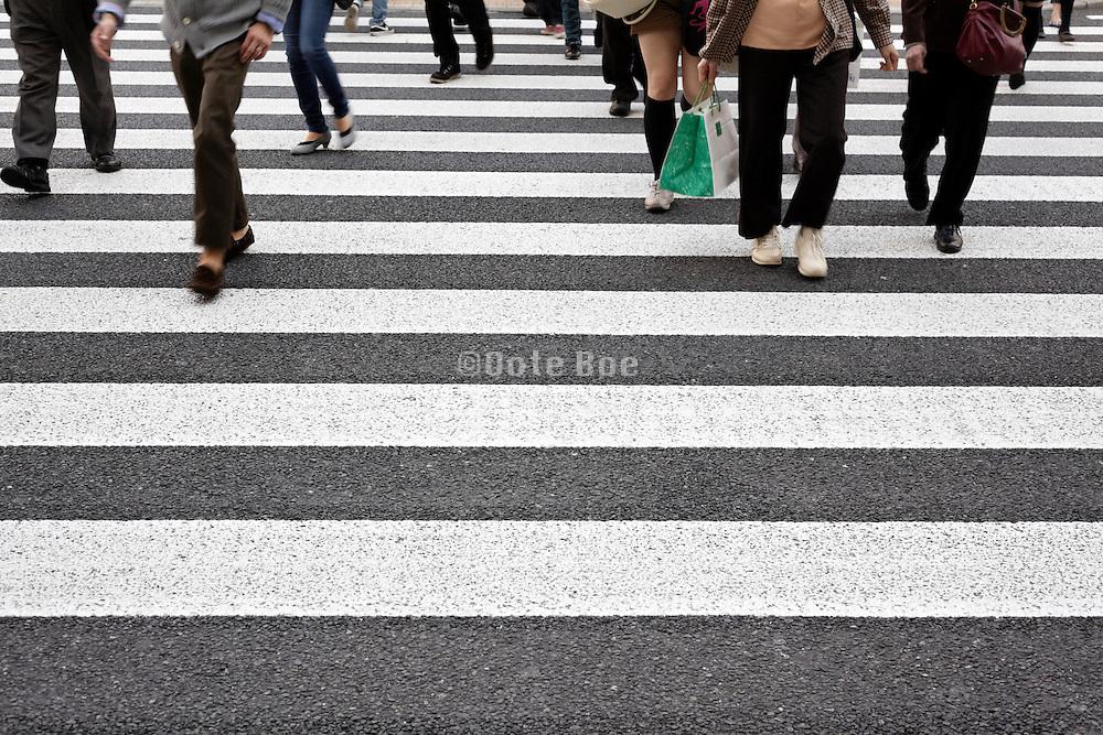 people crossing at a zebra crossing Tokyo Japan
