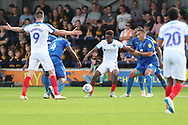 Portsmouth attacker Jamal Lowe (10) holding up ball during the EFL Sky Bet League 1 match between AFC Wimbledon and Portsmouth at the Cherry Red Records Stadium, Kingston, England on 13 October 2018.