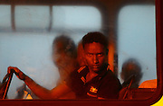 A would-be immigrant looks out of a window on a police bus after arriving at the Armed Forces of Malta (AFM) Maritime Squadron base at Haywharf in Valletta's Marsamxett Harbour early July 10, 2013. Sixty-eight African immigrants were rescued by the AFM, 70 nautical miles south of Malta from a vessel in distress while trying to reach European soil from Africa, according to army sources. REUTERS/Darrin Zammit Lupi (MALTA - Tags: TPX IMAGES OF THE DAY SOCIETY IMMIGRATION POLITICS) MALTA OUT. NO COMMERCIAL OR EDITORIAL SALES IN MALTA - RTX11IWH