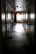 Corridor of a heap hotel in Kamagasaki where day laborers can spend the night for just 1500 yen. They stay in tinny tatami rooms and they share showers and toilets. The hotel is only for men.
