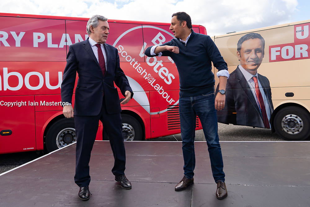 Glasgow, Scotland, UK. 5 May 2021. Scottish Labour Leader Anas Sarwar and former Prime Minister Gordon Brown appear at an eve of polls drive-in campaign rally in Glasgow today. Gordon Brown and Anas Sarwar prepare to elbow bump.   Iain Masterton/Alamy Live News