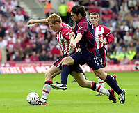 Photo: Greig Cowie, Digitalsport<br /> 27/09/2003.<br /> FA Barclaycard Premiership. Southampton v Middlesbrough, The St Marys Stadium.<br /> Michael Svensson and Malcolm Christie battle it out
