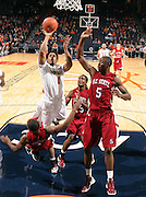 CHARLOTTESVILLE, VA- NOVEMBER 13: Jontel Evans #1 of the Virginia Cavaliers shoots next to South Carolina State Bulldog defenders during the game on November 13, 2011 at the John Paul Jones Arena in Charlottesville, Virginia. Virginia defeated South Carolina State 75-38. (Photo by Andrew Shurtleff/Getty Images) *** Local Caption *** Jontel Evans