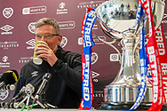 Heart of Midlothian manager Craig Levein takes a sip of coffee as speaks to the press ahead of the Betfred Scottish League Football Cup quarter-final match against Aberdeen, at Oriam Sports Performance Centre, Heriot Watt University, Edinburgh Scotland on 24 September 2019. Picture by Malcolm Mackenzie