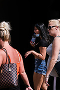 A unknown group of women is pictured as they walk through Huddersfield Town Centre during the 2020 Covid Crisis