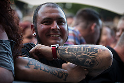 "© Licensed to London News Pictures . 04/07/2015 . Manchester , UK . A man with a The Charlatans tattoo . Fans at the Castlefield Bowl as part of the "" Summer in the City "" festival in Manchester. Photo credit : Joel Goodman/LNP"