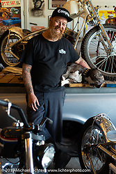 Bill Dodge with his dog Buddy in their Daytona Beach shop. FL, USA. Monday May 16, 2016.  Photography ©2016 Michael Lichter.
