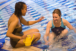 Day Service Officer talking to service user with a learning disability at the local swimming pool,