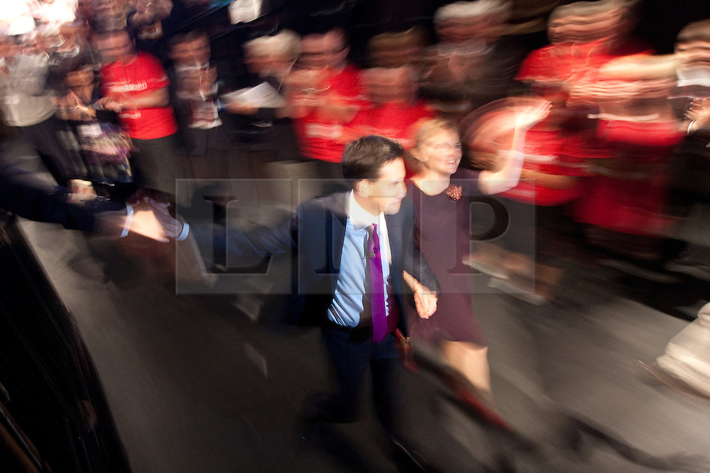 © Licensed to London News Pictures. 02/10/2012. Manchester, UK . Ed Miliband and his wife Justine Thornton leave the conference hall after he delivers his speech to the Labour Party Conference at Manchester Central . Photo credit : Joel Goodman/LNP