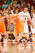 Jan 8, 2012; Fayetteville, AR, USA; Tennessee Lady Volunteers forward Alicia Manning (15) attempts to gain control of the ball as Arkansas Razorbacks center Sarah Watkins (4) looks on during a game at Bud Walton Arena. Tennessee defeated Arkansas 69-38. Mandatory Credit: Beth Hall-US PRESSWIRE